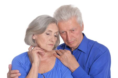 Portrait of sad senior couple on white background Stock Photo