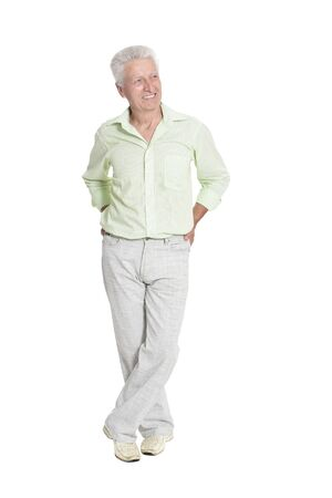 Full length portrait of senior man posing on white background