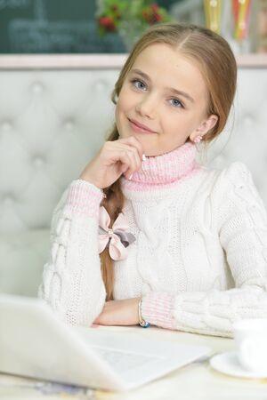 Portrait of cute beautiful girl using laptop