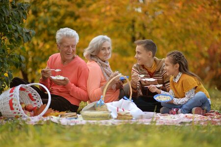 Portrait of family on picnic in autumn