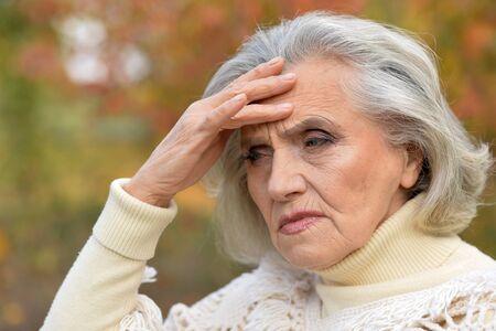 Close up portrait of sad woman posing outdoors