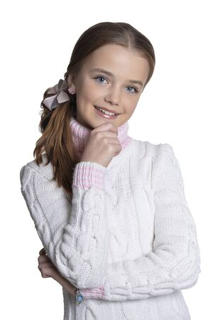 Portrait of smiling little girl wearing warm sweater on white background Stock Photo