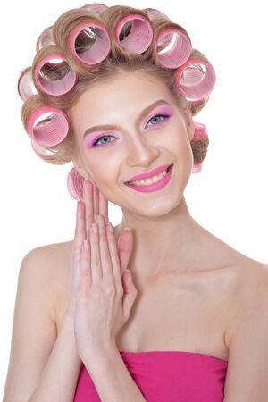 Beautiful woman wearing pink dress isolated on white background Stockfoto
