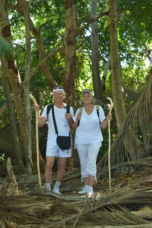 Portrait of happy elderly couple in tropical forest