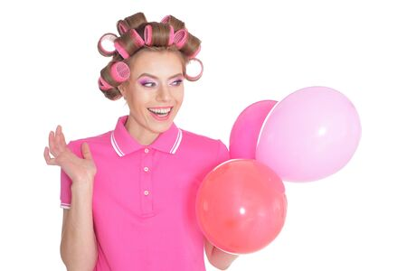 Beautiful woman in hair curlers isolated on white background