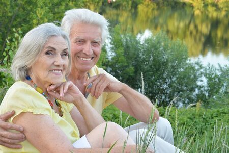 Portrait of beautiful senior couple in the park Stock Photo