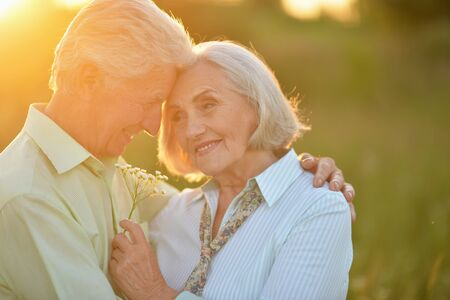 Portrait of beautiful senior couple relaxing in the spring park