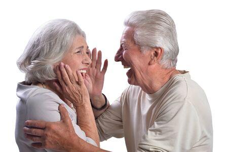 Happy beautiful senior couple posing on white background