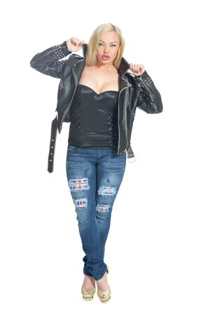 Beautiful woman in a leather jacket posing isolated on white 免版税图像