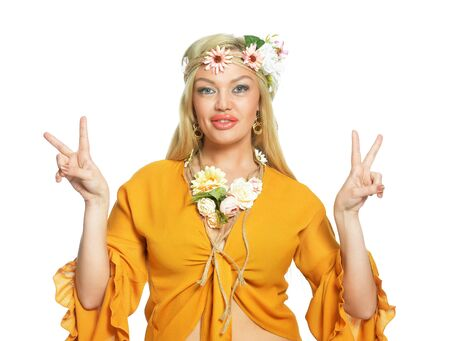 Close up portrait of beautiful young woman showing peace signs on white background 免版税图像