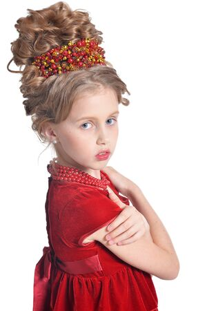 Portrait of cute girl in red dress posing isolated