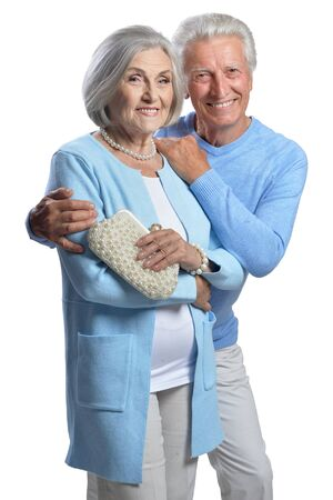 Happy senior couple embracing and posing on white background 写真素材