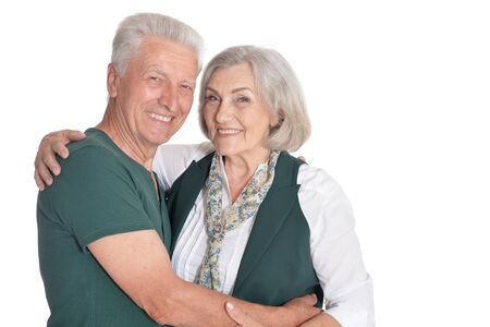 Happy senior couple posing on white background
