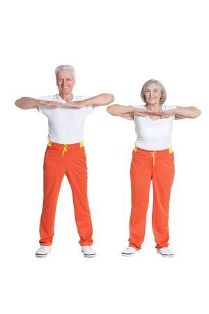 Senior couple exercising isolated on white background