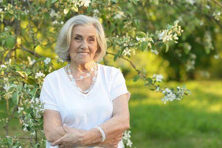 Portrait of senior beautiful woman in spring park