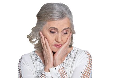 Close up shot of upset mature woman on white background Banco de Imagens