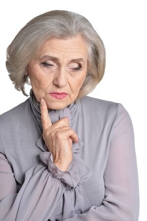 Portrait of sad senior woman posing isolated