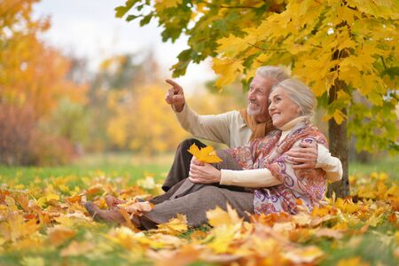 Happy senior woman and man in park