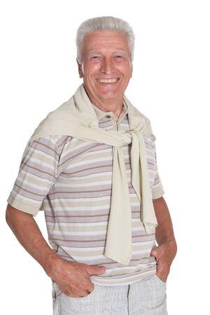 Portrait of senior man holding hands in pockets posing