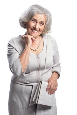Happy senior woman wearing light dress posing isolated Banco de Imagens