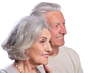 Happy senior couple embracing and posing on white background 版權商用圖片