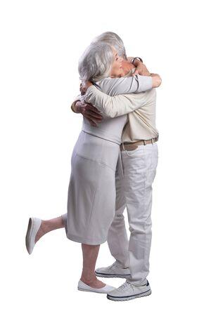 Happy senior couple embracing and posing on white background Фото со стока