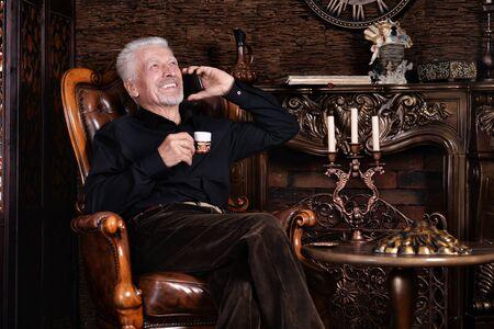 Portrait of smiling senior man drinking coffee