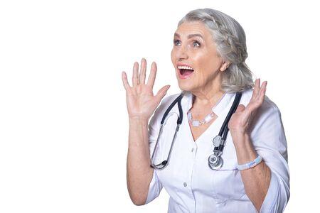 Portrait of happy senior doctor posing on white background