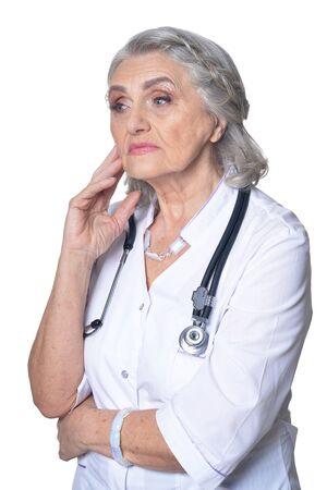Portrait of female senior doctor on white background Stock fotó