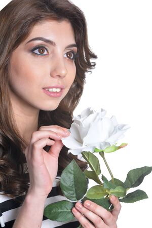 close up portrait of beautiful brunette young woman with white flower