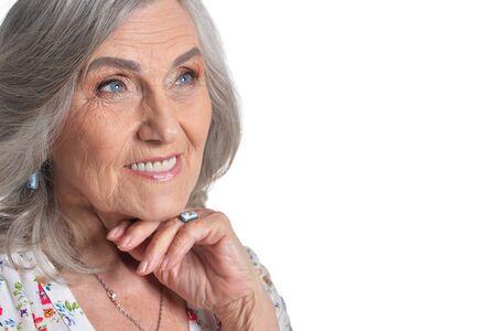 Portrait of happy senior woman on white background
