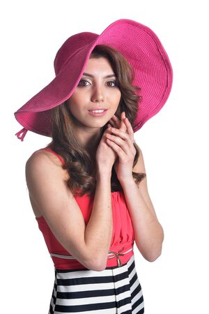 close up portrait of beautiful brunette young woman in pink hat Фото со стока
