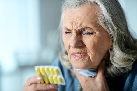 Portrait of sad sick senior woman with pills Reklamní fotografie