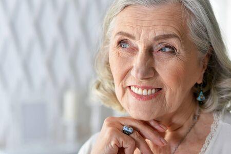Portrait of happy senior woman at home Banco de Imagens