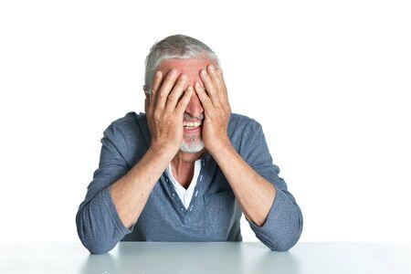 Emotional senior man isolated on white background Imagens