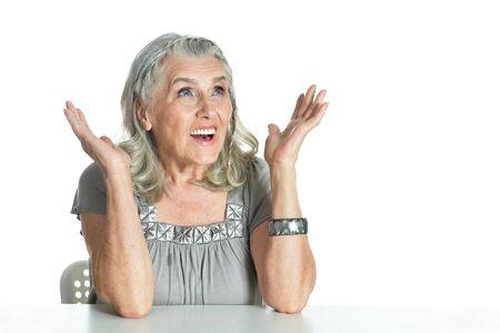 Portrait of emotional senior woman posing isolated on white background