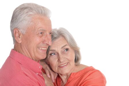 Smiling senior couple wearing bright clothing isolated