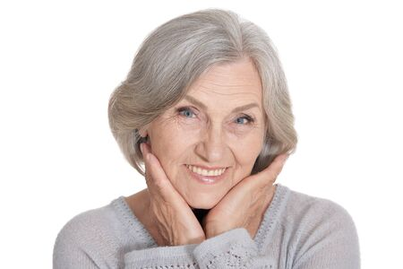 Beautiful senior woman, posing against white background