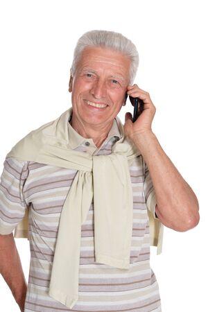 Portrait of confident senior man using phone Imagens
