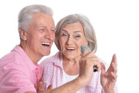 portrait of Senior couple singing with microphone