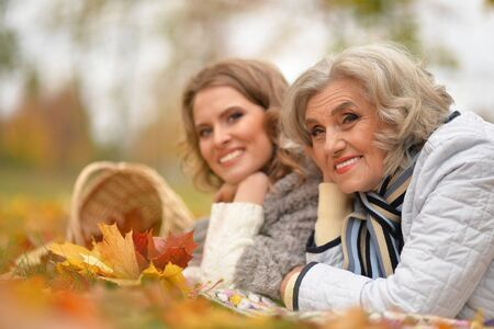 Close up portrait of smiling senior woman with adult daughter