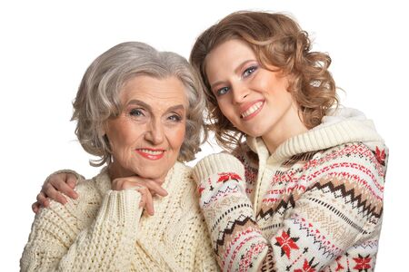 Portrait of smiling senior mother and her daughter