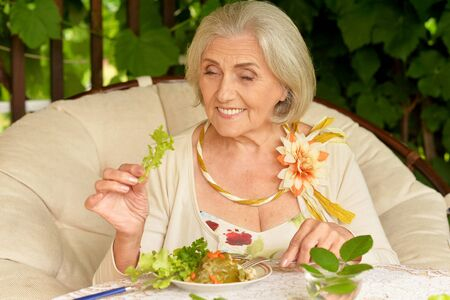 Portrait of a beautiful senior woman eating healthy breakfast