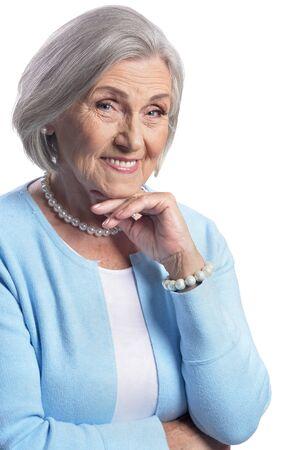 Portrait of beautiful senior woman posing isolated