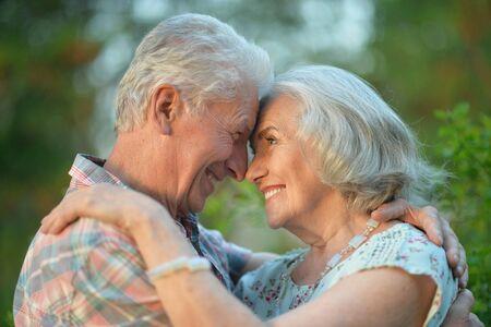 senior couple hugging in the summer park