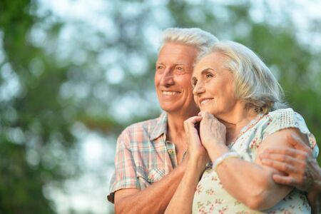 Portrait of senior couple embracing in the park