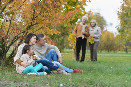 Portrait of cute happy smiling family relaxing