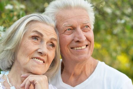Portrait of senior couple posing in the park