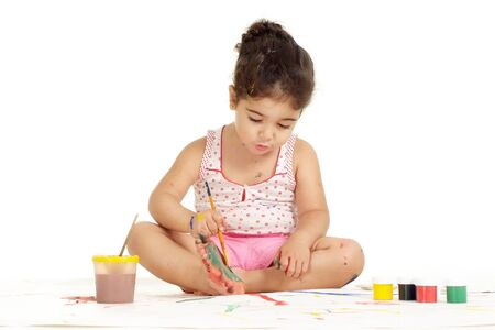 Portrait of nice young girl painting picture on a white background Imagens