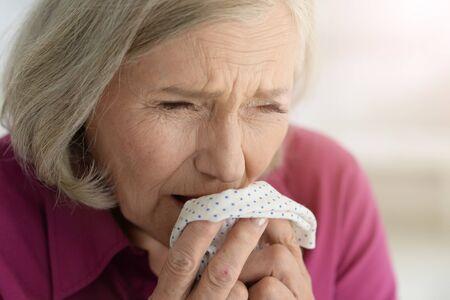 Close up portrait of sad ill senior woman